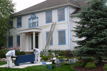 Heritage Home being painted by crew