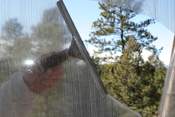window being washed by hand
